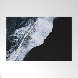 Waves crashing on a black sand beach – minimalist Landscape Photography Welcome Mat