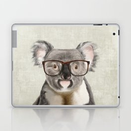 A baby koala with glasses on a rustic background Laptop & iPad Skin