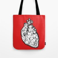 anatomical heart Tote Bags featuring Anatomical Heart by Horse and Hare