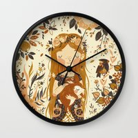 rabbits Wall Clocks featuring The Queen of Pentacles by Teagan White