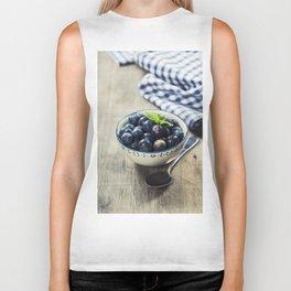 Fresh summer Blueberries on wooden background Biker Tank