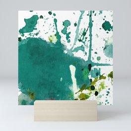 emerald green splash Mini Art Print