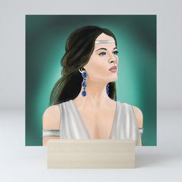 The woman with sapphire earrings Mini Art Print
