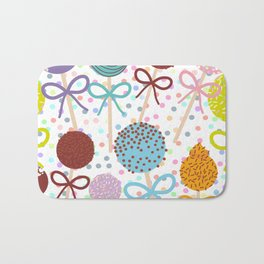 seamless pattern Colorful Sweet Cake pops set with bow on white polka dot background Bath Mat