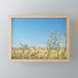 the wind swinging the flowers Framed Mini Art Print