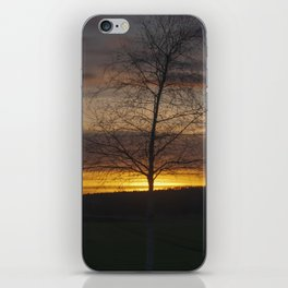 Sunset at the end of town iPhone Skin