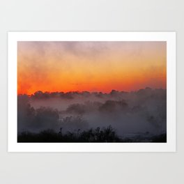 Sunrise with fog at an African river Art Print