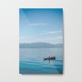 Guatemalan fisherman rows fishing boat canoe to cast net in Lake Atitlán, Guatemala Metal Print