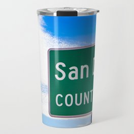 Closeup of the San Diego County Line Sign against a Blue Sky in the Anza Borrego Desert State Park Travel Mug