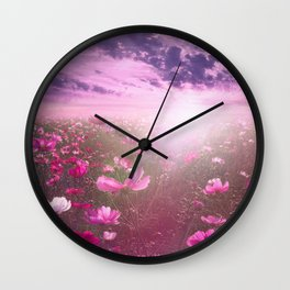 Wild Mexican Aster fields amid the purple sunset Wall Clock