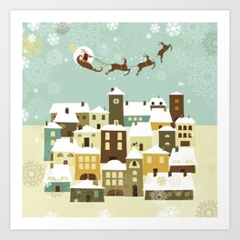 Santa flying in his sleigh over a village Art Print