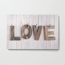 The word 'love' in wooden letters on a rustic background Metal Print