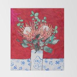 Delft Bird Vase of Proteas on Red Throw Blanket
