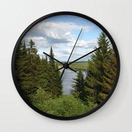 Landscape view on the taiga in Kargort village in Komi Republic of Russia. Wall Clock