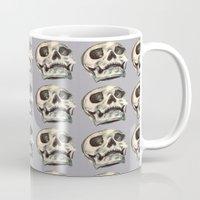 skulls Mugs featuring Skulls by Lauren Draghetti