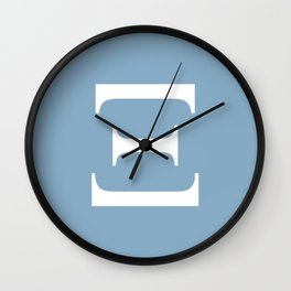 Greek letter Xi sign on placid blue background Wall Clock