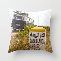 casablanca Throw Pillows featuring Casablanca milestone with old Volkswagen microbus by Premium