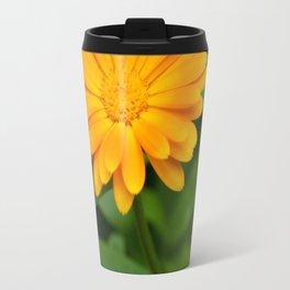 Yellow flower calendula officinalis and green leaves on background Travel Mug