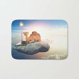 Kiwi and camel riding on a rock in the sky by GEN Z Bath Mat