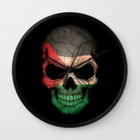 palestine Wall Clocks featuring Dark Skull with Flag of Palestine by Jeff Bartels