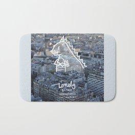 Lonely Dino - in Paris Bath Mat