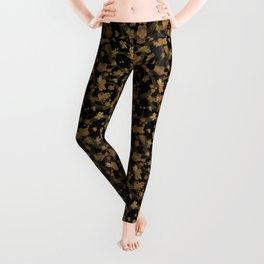 Brown - yellow pattern grunge on black background . Leggings