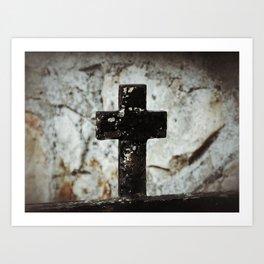 Wrought iron cross against stone Art Print