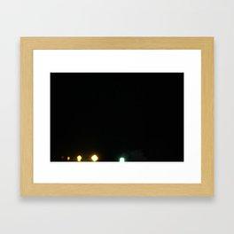 Signs of light against the dark of night Framed Art Print