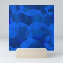 Abstract soap of blue molecules and blue bubbles on a marine background. Mini Art Print