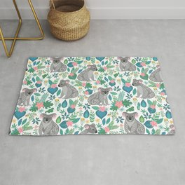 Cute gray koalas with ornaments, tropical flowers and leaves. Seamless tropical pattern. Rug