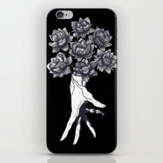 Hand with lotuses on black iPhone Skin
