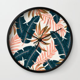 Botanical seamless tropical pattern with bright plants and leaves on a beige background. Seamless exotic pattern with tropical plants. Exotic jungle wallpaper. Wall Clock