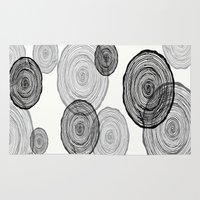 tree rings Area & Throw Rugs featuring rings by Claire Rose Kleese