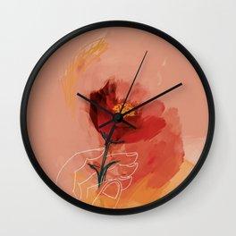 Hand Holding Flower Wall Clock