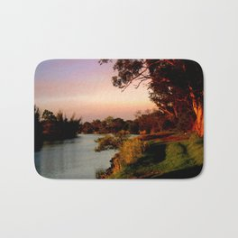 Reflecting sunset on the river Bank Bath Mat