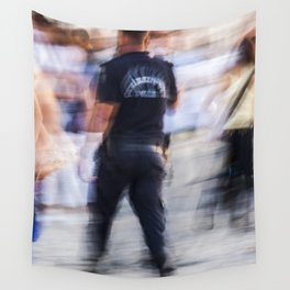 Turkish policeman moving in the crowd Wall Tapestry