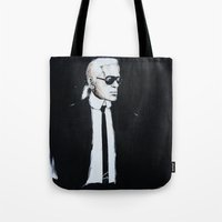 karl lagerfeld Tote Bags featuring Karl Lagerfeld back in black by Alexis Olin
