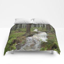 Water always flows downhill Comforters