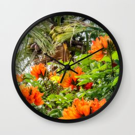 The beautiful red flowers of the African Tulip Tree at Kuto Bay Beach Wall Clock