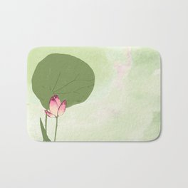 Survive like a lotus flower, rising from the muc Bath Mat