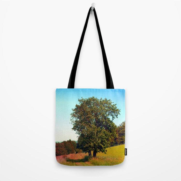 Old tree, vibrant surroundings Tote Bag