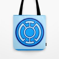 green lantern Tote Bags featuring Green Lantern: Blue Lantern by The Barefoot Hatter