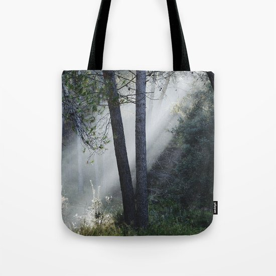 """Sunrays through the foggy forest"". Retro dreams.... Tote Bag"