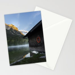 Boathouse with lifesaver Portrait. Amazing shot of a wooden house in the Ferchensee lake in Bavaria, Germany, in front of a mountain belonging to the Alps. Scenic foggy morning scenery at sunrise. Stationery Cards