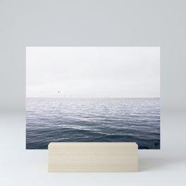 A calm sea Mini Art Print