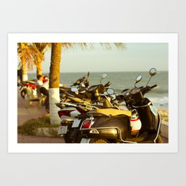 Scooters parked on parking with sea bay on the city beach Art Print