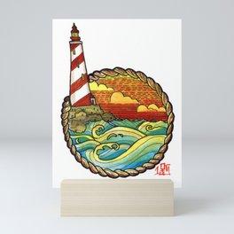 Lighthouse at sunset Mini Art Print