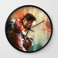 iron man Wall Clocks featuring The man of Iron by Wisesnail