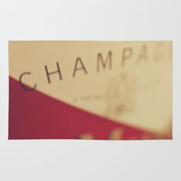 Champagne bottle, macro photography of old wine label on museum paper, still life, bar, home decor Rug