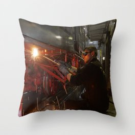 Welding works on a steam locomotive. Throw Pillow